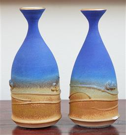 Sale 9097H - Lot 13 - A pair of Marianne Cole (Adelaide) ceramic outback vases with gold lustre rim, Height 18cm (chip to one)