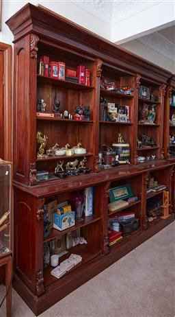 Sale 9103H - Lot 3 - A mahogany three bay book shelf with carved scrolled corbels, Height 230cm x Width 250cm x Depth 46cm