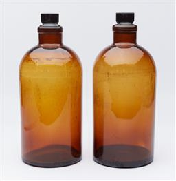 Sale 9123J - Lot 349 - A pair of large amber coloured apothecary bottles with stoppers, each height 37cm