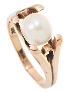 Sale 9149 - Lot 348 - A GOLD SOLITAIRE PEARL RING; set with a 7mm off round cultured pearl (flat spot) on tapered spit shoulders, sized to K, wt. 4.26g.