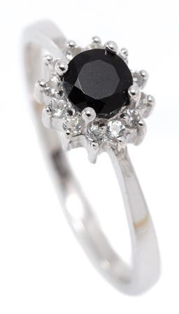 Sale 9164J - Lot 504 - A BLACK DIAMOND AND TOPAZ RING; silver star burst centring a round brilliant cut black diamond of approx. 0.37ct to surround of roun...