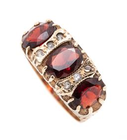 Sale 9253J - Lot 362 - A VICTORIAN STYLE 9CT GOLD GEMSET RING; belcher set across the top with 3 oval cut garnet and 6 small round cut white stones to scro...