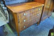 Sale 8390 - Lot 1077 - Louis XVI Style Commode with a parquetry top and three chequerboard drawers on tapering legs