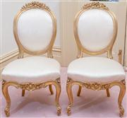 Sale 8430 - Lot 6 - A pair of Louis XVI transitional gilt side chairs upholstered in cream floral fabric and on cabriole legs