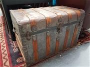 Sale 8843 - Lot 1010 - Large Timber and Metal Bound Travelling Trunk with Ornate Fittings