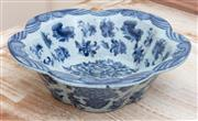 Sale 8866H - Lot 62 - A crackle glazed blue and white scalloped edge bowl decorated with floral swags, Height 16cm, Diameter 29cm
