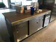 Sale 8984M - Lot 19 - A commercial warming oven with three sliding doors