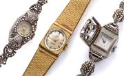Sale 8999 - Lot 340 - THREE LADYS VINTAGE WRISTWATCHES; a gold plated Bucherer with oval sunburst dial on a 17 jewel movement, boxed, a marcasite deco st...