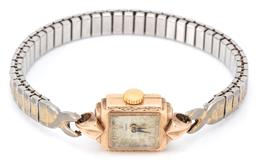Sale 9132 - Lot 375 - A 10CT GOLD VINTAGE TUDOR LADYS WRISTWATCH; square dial, applied with Arabic markers, fancy lugs, 17 jewell movement, metal band, c...