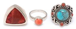 Sale 9156J - Lot 316 - THREE SILVER STONE SET RINGS; one set with a faux turquoise and 4 coral beads on 26mm wide scrolling mount with butterfly shoulders,...