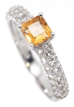 Sale 9164J - Lot 485 - A CITRINE AND TOPAZ RING; claw set in silver with a carre cut citrine above shoulders set with round cut white topaz, size M, width...