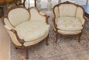 Sale 8341A - Lot 64 - A lovely pair of Louis XV style carved walnut tub chairs upholstered in gold floral silk