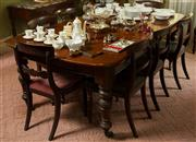 Sale 8418A - Lot 39 - A cedar extension dining table on turned legs to castors, fully extended L 210 x W 124cm, with winder