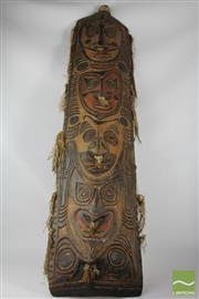 Sale 8520T - Lot 124 - Carved Shield with Painted Faces 146cm x 30cm