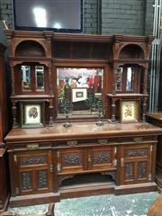 Sale 8882 - Lot 1088 - Large Victorian Aesthetic Carved Walnut Breakfront Sideboard, with an arched hood, with multiple mirrors & shelves, with three drawe...