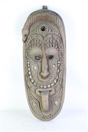 Sale 8972M - Lot 655 - Carved Cultural Mask (L: 57cm) (some losses to shells)
