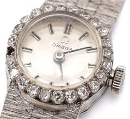 Sale 9132 - Lot 423 - A VINTAGE OMEGA LADYS DIAMOND WRISTWATCH; in stainless steel with sunburst silver dial, applied markers, 17 jewel cal. 484 manual mo...