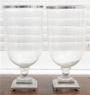 Sale 9081H - Lot 104 - A pair of glass hurricane lamps with chrome base and trim, Height 43cm x Diameter 20cm