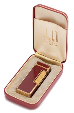Sale 9099 - Lot 71 - A Red Dunhill lighter in original case., length 6.5cm