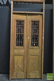 Sale 8257 - Lot 1003 - Pair of Large Entrance Doors, with iron inserts