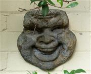 Sale 8838H - Lot 9 - A wall mount of a smiling man. Height 22cm