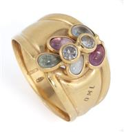 Sale 8879 - Lot 337 - AN 18CT GOLD ITALIAN STONE SET RING; 14mm wide top set with synthetic cabochon spinels and 2 white stones by DML jewells, size Q, wt...