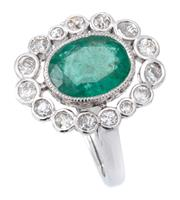 Sale 9066A - Lot 47 - AN EMERALD AND DIAMOND CLUSTER RING; millegrain set with an oval cut emerald of approx. 2.68ct to a surround of 15 individual collet...