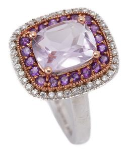 Sale 9194 - Lot 335 - A TWO TONE SILVER STONE SET RING; centre set with a rectangular cushion cut pale amethyst to double surround of round cut amethysts...