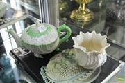 Sale 8217 - Lot 40 - Belleek Neptune Teapot with a Belleek Vase with Book