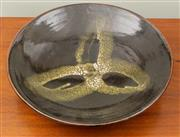 Sale 8653A - Lot 19 - A black glazed ceramic bowl by Harold Hughan, D 42cm, monogrammed to base