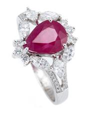 Sale 9066A - Lot 35 - AN 18CT WHITE GOLD RUBY AND DIAMOND RING; featuring an approx. 2.40ct pear cut ruby to surround and split shoulders set with 6 marqu...
