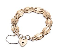 Sale 9253J - Lot 355 - A 9CT GOLD GATELINK BRACELET; engraved and plain links to heart shape padlock clasp (some scratches), hallmarked LC London 1978, wit...