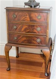 Sale 8308A - Lot 148 - An English Reprodux flamed mahogany bow front 3 drawer brass handled bedside chest raised on cabriole legs. Ht: 69cm x W:48 x D: 35