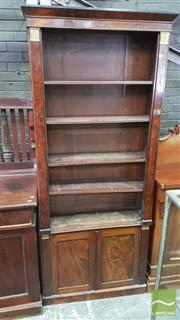 Sale 8375 - Lot 1084 - C19th Mahogany Empire-Style Bookcase, with brass mounts, four open shelves above two panel doors (key in office)
