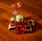 Sale 8418A - Lot 43 - A quantity of cranberry glass cruet wares including stand and salts