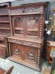 Sale 8634 - Lot 1082 - Late 19th Century Flemish Carved Oak Buffet, with two glass panel doors with barley twist supports, two mask head drawers & two door...