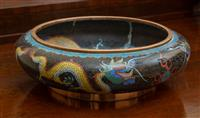 Sale 8735 - Lot 93 - A cloisonne bowl with dragon design and character marks to base, diameter 31.5