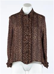 Sale 9003F - Lot 29 - A Burberry silk mix brown top with Burberry print, size 10.