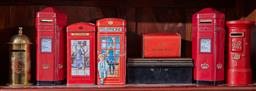 Sale 9103H - Lot 5 - A group of money boxes in tin, ceramic and cast with telephone and postal themes, Tallest 20cm