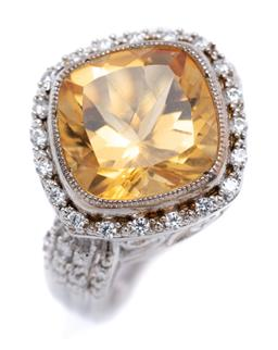 Sale 9194 - Lot 327 - A SILVER CITRINE AND STONE SET RING; featuring a cushion cut citrine of approx. 7.50ct to zirconia set surround and shoulders on scr...