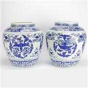 Sale 8221 - Lot 9 - Chia Ching Marked Pair of Blue & White Phoenix Jars
