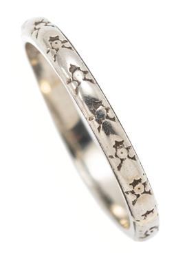 Sale 9164J - Lot 304 - AN 18CT WHITE GOLD BAND; 2.3mm wide band with engraved pattern, size M, wt. 2.52g.