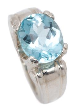 Sale 9194 - Lot 577 - A SILVER TOPAZ AND STONE SET RING; double claw set with an oval cut blue topaz on gallery set with 2 round cut zirconias to scroll s...
