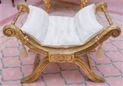 Sale 8430 - Lot 85 - A pair of X framed stools, gilt with turned rails having cream upholstery and matching loose cushions with loose tassels