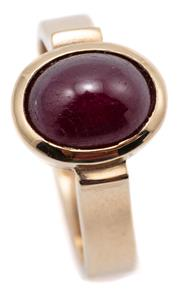 Sale 9090J - Lot 352 - A 9CT GOLD SOLITAIRE RUBY RING; rub set with an approx. 1.80ct cabochon ruby on a 3.4 wide upswept shank, size I 1/2, wt. 3.58g.