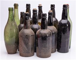 Sale 9185E - Lot 129 - A collection of twelve glass bottles, tallest Height 31cm