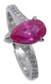 Sale 9066A - Lot 66 - AN 18CT WHITE GOLD DIAMOND AND STONE SET RING; centring a pear cut synthetic ruby (abraded) to bypass shoulders set with 16 round br...
