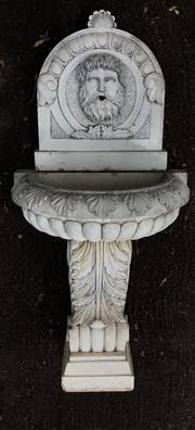 Sale 8706A - Lot 5 - A carved stone fountain depicting head of Neptune, fountain consists of 3 parts, general wear, chipping, H 151 x W 74cm