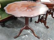 Sale 8792 - Lot 1021 - Georgian Style Mahogany Occasional Table, the shaped tilt top with raised edge on a turned, stopped flutes pedestal and carved outsw...