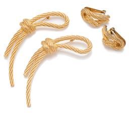 Sale 9099 - Lot 145 - A pair of Christian Dior costume brooches, width 10cm, together with a matching pair of earrings in rope design.